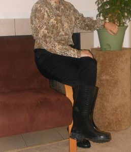 Animal print tie neck blouse: (thrifted.) Black skinnies: JC Penney. Black rain boots: Old Navy. Brown watch: Wal-Mart.