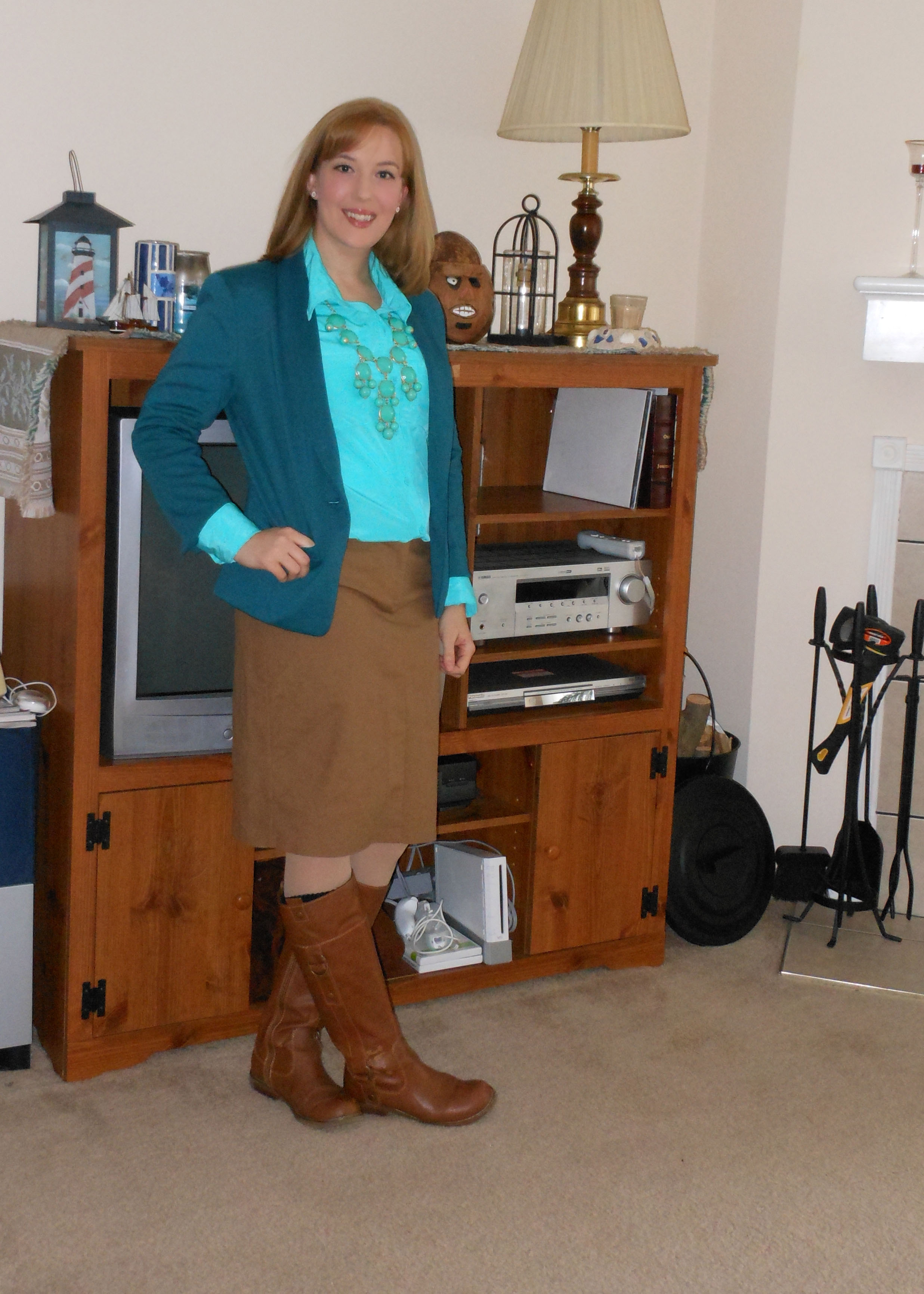 Teal blazer: Target. Daisy stud earrings: Target. Turquoise silky button up: Wal-Mart. Bubble necklace: online. Dark khaki skirt: (thrifted.) Nude tights: Wal-Mart. Brown boots: Old Navy. Rose gold watch: Target.