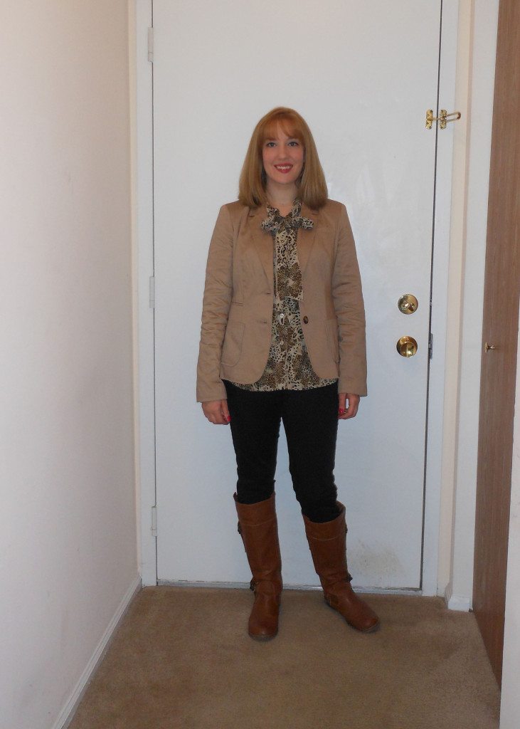 Khaki blazer: Wal-Mart. Feather earrings: Charlotte Russe. Leopard print tie-neck blouse: (thrifted.) Black skinny pants: JC Penney. Gold watch: Target. Brown boots: Old Navy.