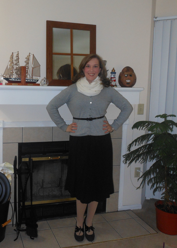 Cream infinity scarf: Wal-Mart. Gray cardigan: Old Navy. Black belt: from another dress. Black skirt: Wal-Mart. Nude tights: Wal-Mart. Black and gray shoes: Payless. Silver earrings: Silver watch: Fossil.