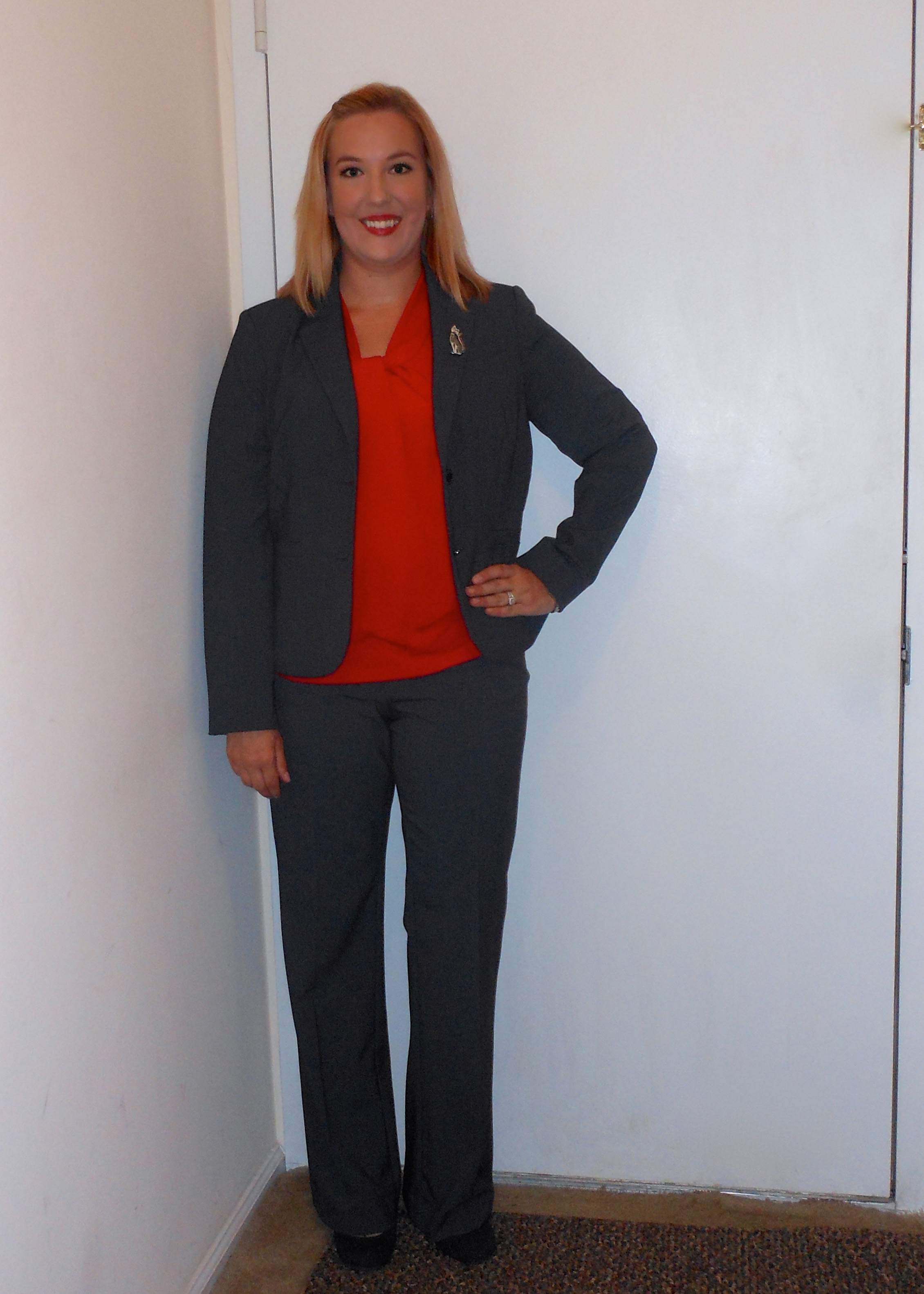 teach in style minus m interview attire grey calvin klein suit grey pants grey blazer red sleeveless top black and grey shoes cat pin